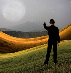 Man touches sky in landscape creting ripples in the scene